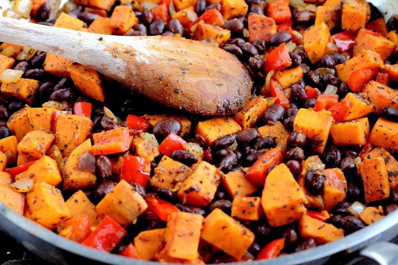 Vegetarian enchiladas black bean and sweet potato cotija sharp cheddar cilantro