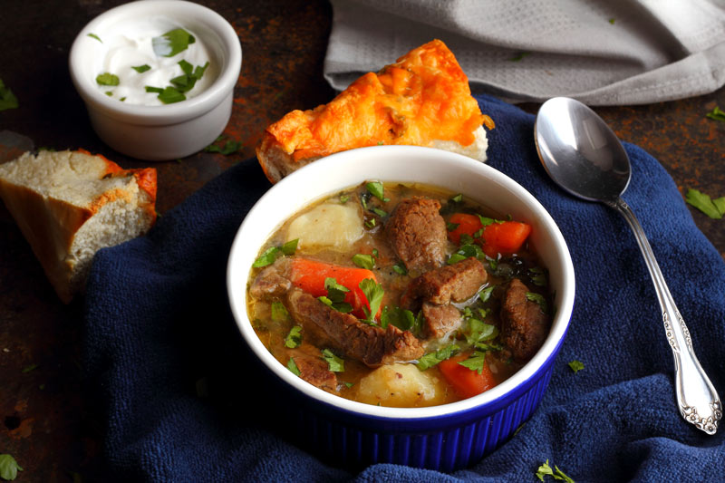Traditional Irish Stew Recipe in a bowl for eating. Carrots, Potatoes, Onions, Beef, Parsley